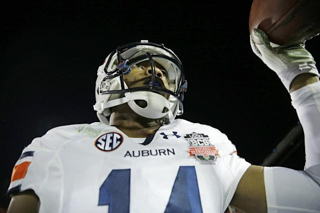 Auburn's Nick Marshall celebrates his touchdown run during the first half of the NCAA BCS National Championship college football game against Florida State Monday, Jan. 6, 2014, in Pasadena, Calif. (AP Photo/David J. Phillip)