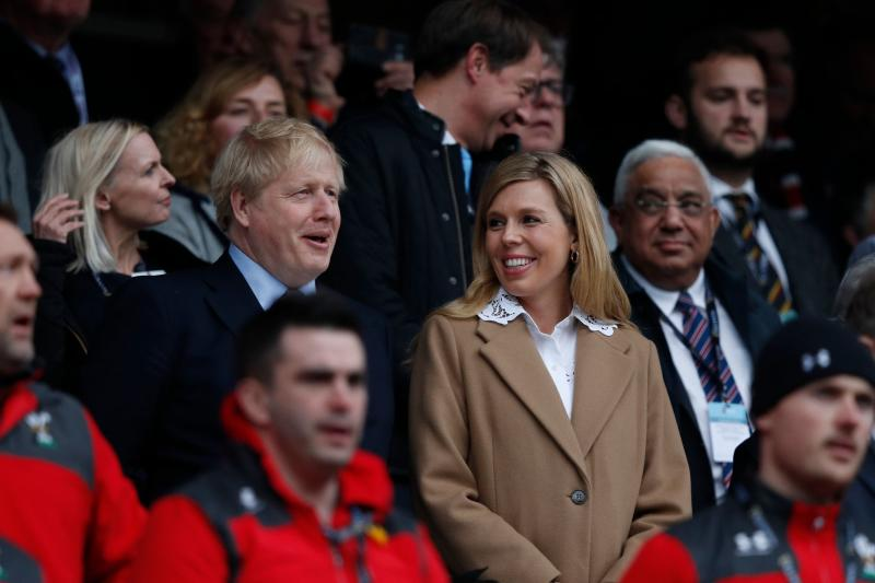 Britain's Prime Minister Boris Johnson (L) with his partner Carrie Symonds attend the Six Nations international rugby union match between England and Wales at the Twickenham, west London, on March 7, 2020. (Photo by Adrian DENNIS / AFP) (Photo by ADRIAN DENNIS/AFP via Getty Images)