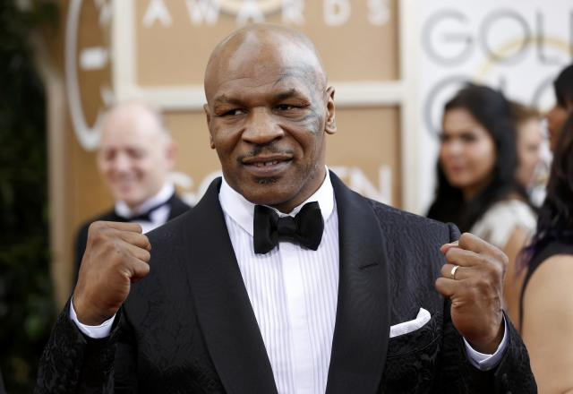 Boxer Mike Tyson arrives at the 71st annual Golden Globe Awards in Beverly Hills, California January 12, 2014. REUTERS/Mario Anzuoni (UNITED STATES - Tags: ENTERTAINMENT SPORT BOXING) (GOLDENGLOBES-ARRIVALS)