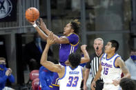 Western Illinois' Anthony Jones drives to the basket past DePaul's Pauly Paulicap (33) and Oscar Lopez Jr. during the first half of an NCAA college basketball game Wednesday, Dec. 23, 2020, in Chicago. (AP Photo/Charles Rex Arbogast)