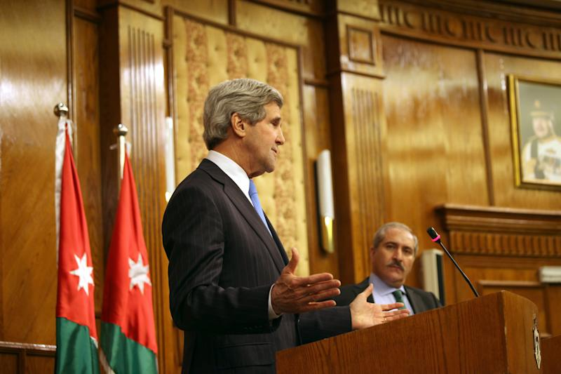 """U.S. Secretary of State John Kerry, left, speaks during a joint news conference with his Jordanian counterpart, Nasser Judeh, right, in Amman Wednesday, May 22, 2013. Secretary of State John Kerry says the United States and its Arab and European allies will step up their support for Syria's opposition to help them """"fight for the freedom of their country"""" if President Bashar Assad's regime doesn't engage in peace talks in good faith. (AP Photo/Mohammad Hannon)"""