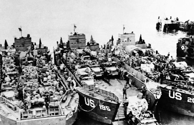 <p>Landing craft loaded with invasion assault landing craft tanks are loaded with half tracks and other armored vehicles by American troops at an embarkation point in England on June 6, 1944, just before they set sail for the D-Day invasion of the French coast. (Photo: AP) </p>