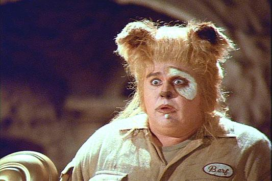 "<p><strong>""Spaceballs"" (1987)</strong></p> <p>Mel Brooks' ridiculous science fiction send-up ""Spaceballs"" featured Candy in the role of Barf, the half-man, half-dog  companion of the roguish Captain Lone Starr (Bill Pullman). A slapstick Chewbacca to Pullman's goofy Han Solo type. Candy was one of three people required to operate the elaborate Barf costume. He controlled Barf's tail, while two others had to operate Barf's ears. Candy had to wear a 30-pound battery pack on his back to power the animatronics built into the costume.</p>"