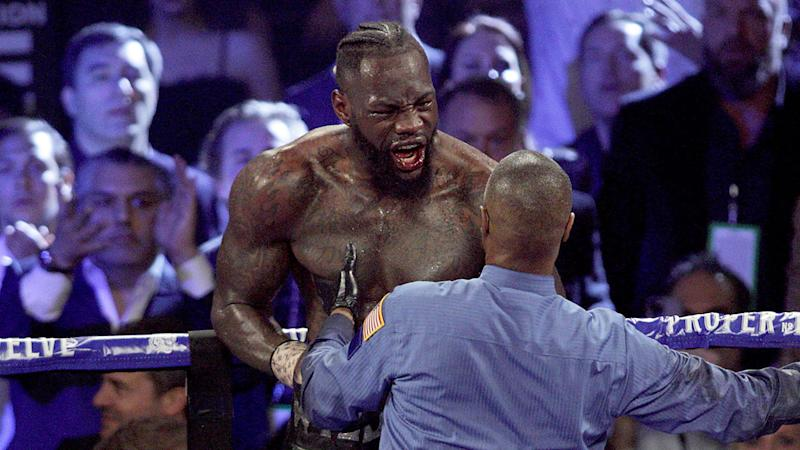 Seen here, Deontay Wilder reacts angrily to his seventh round TKO loss to Tyson Fury.