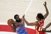 Brooklyn Nets' James Harden (13) is defended Atlanta Hawks' De'Andre Hunter (12) during the first half of an NBA basketball game Wednesday, Jan. 27, 2021, in Atlanta. (AP Photo/Brynn Anderson)