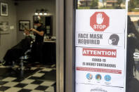 """LAGUNA HILLS, CA - MAY 05: Customers maintain safety protocols at The BarberHood in Laguna Hills, CA, on Tuesday, May 5, 2020. The shop is one of the first to re-open and defy the state""""u2019s stay-at-home order during the COVID-19 (coronavirus) lockdown. (Photo by Paul Bersebach/MediaNews Group/Orange County Register via Getty Images)"""