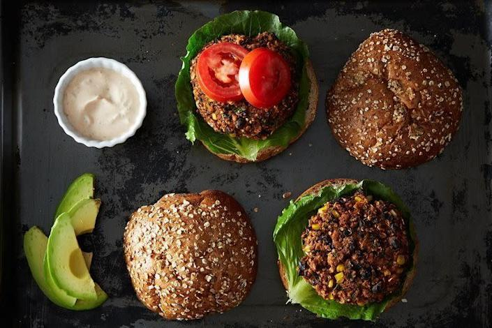 """<strong>Get the <a href=""""https://food52.com/recipes/19635-black-bean-and-quinoa-veggie-burgers"""" rel=""""nofollow noopener"""" target=""""_blank"""" data-ylk=""""slk:Black Bean and Quinoa Veggie Burgers recipe"""" class=""""link rapid-noclick-resp"""">Black Bean and Quinoa Veggie Burgers recipe</a> from Sonali aka the Foodie Physician via Food52</strong>"""