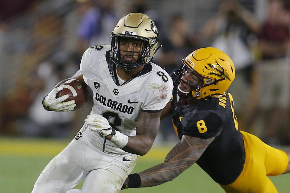 Colorado running back Alex Fontenot runs away from Arizona State linebacker Merlin Robertson (8) in the second half during an NCAA college football game, Saturday, Sept. 21, 2019, in Tempe, Ariz. Colorado defeated Arizona State 34-31. (AP Photo/Rick Scuteri)