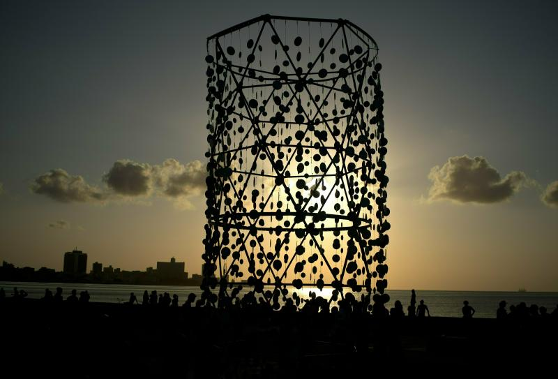 "In this April 14, 2019 photo, people walk around an art installation during the inauguration of the exhibition ""Behind the Wall,"" at the 13th Havana Biennial, in Havana, Cuba. American and international artists have flocked to Havana's Bienal, an art show designed to showcase new works and foster an appreciation of art among the public, while giving new artists a venue to display their work. (AP Photo/Ramon Espinosa)"