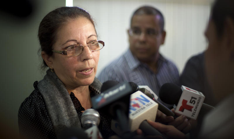 Ofelia Acevedo, the wife of the late Cuban dissident Oswaldo Paya who died in a car crash, talks to the media talk about her family's decision to seek political refuge in the U.S., in Miami, Fla., Tuesday, July 18, 2013. Paya was killed in a car crash along with another dissident in 2012 in Cuba. (AP Photo/J Pat Carter)