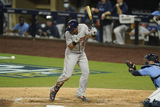 Houston Astros Michael Brantley (23) is hit by a pitch from Tampa Bay Rays relief pitcher Aaron Loup during the eighth inning in Game 1 of a baseball American League Championship Series, Sunday, Oct. 11, 2020, in San Diego. (AP Photo/Gregory Bull)
