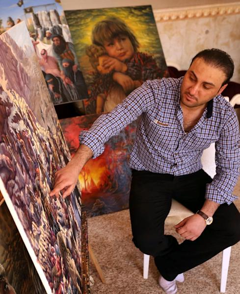 Painter Ammar Salim fled the town of Bashiqa when IS fighters took over Mosul in June 2014 in an onslaught that overran large areas of Iraq (AFP Photo/-)