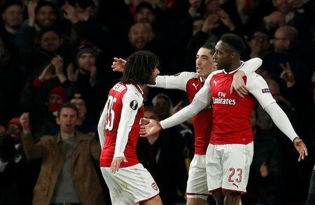 Soccer Football - Europa League Round of 16 Second Leg - Arsenal vs AC Milan - Emirates Stadium, London, Britain - March 15, 2018 Arsenal's Danny Welbeck celebrates scoring their third goal with teammates Action Images via Reuters/John Sibley
