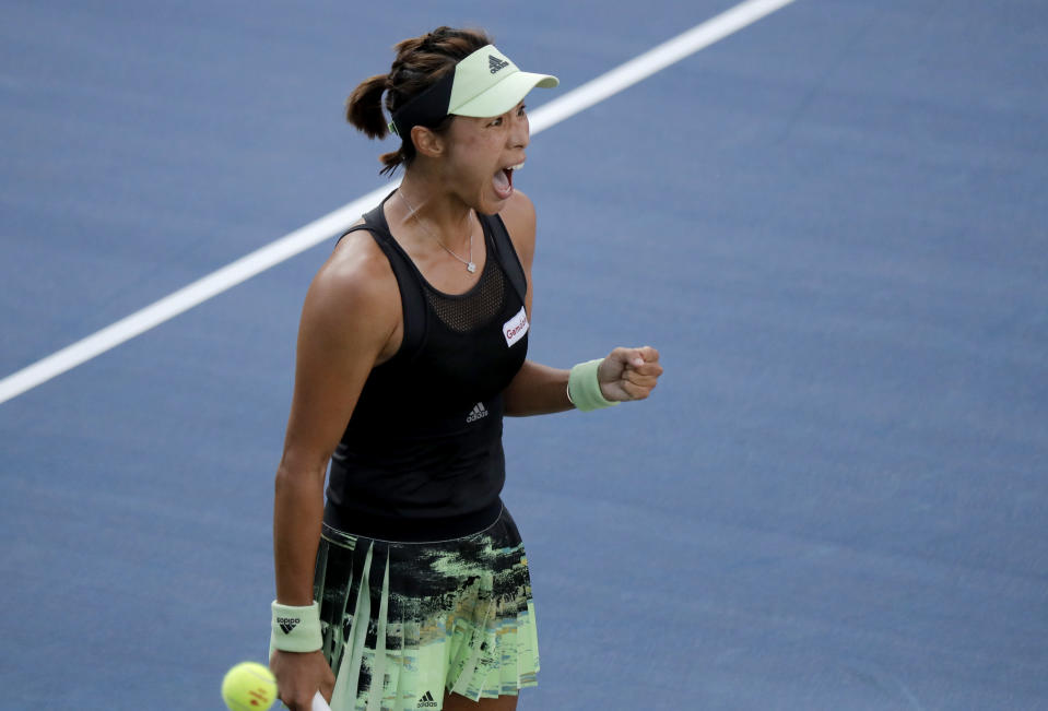 Wang Qiang, of China, reacts after defeating Fiona Ferro, of France, during round three of the US Open tennis championships Friday, Aug. 30, 2019, in New York. (AP Photo/Eduardo Munoz Alvarez)
