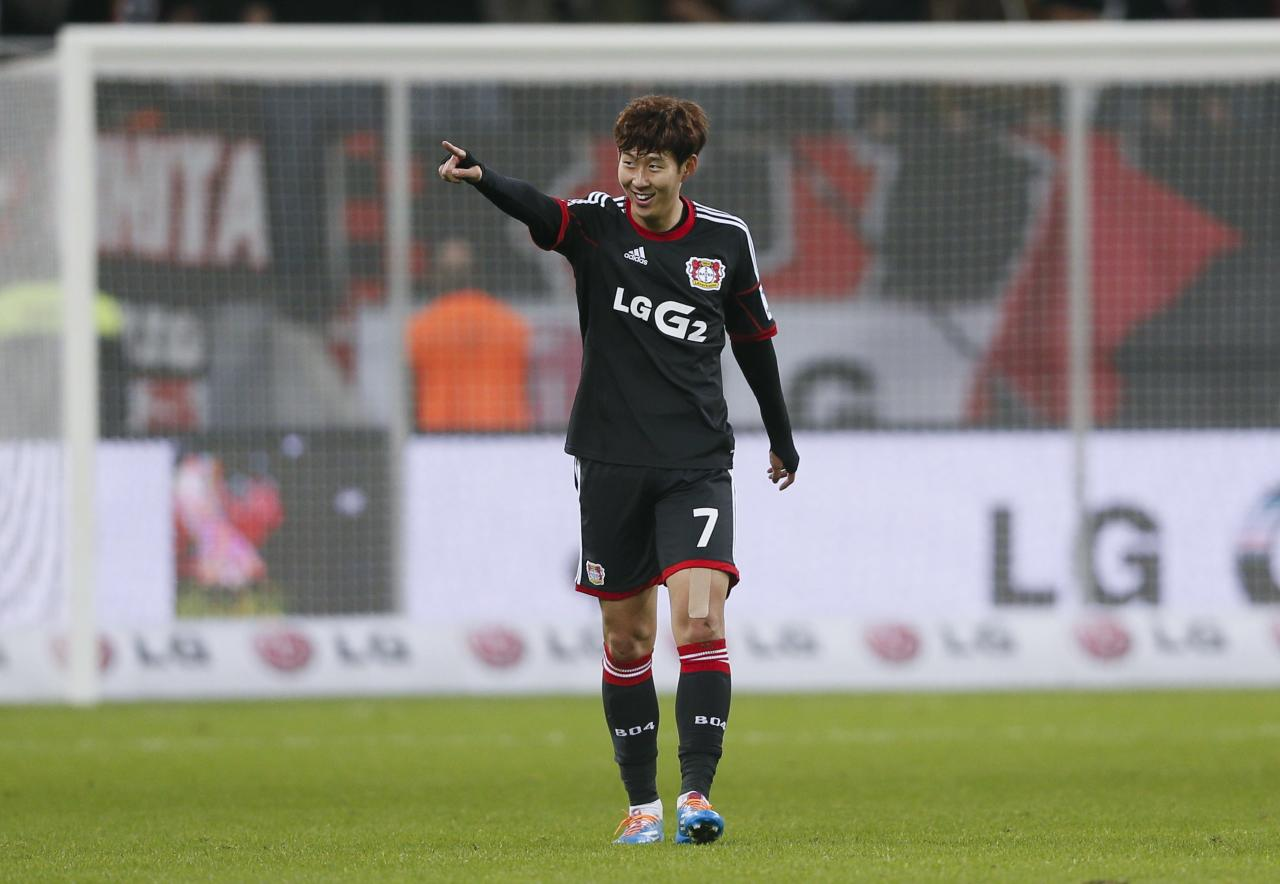 REFILE - Bayer 04 Leverkusen's Son Heung-Min celebrates his goal against FC Nuremberg during their German first division Bundesliga soccer match in Leverkusen November 30, 2013. REUTERS/Wolfgang Rattay (GERMANY - Tags: SPORT SOCCER) DFL RULES TO LIMIT THE ONLINE USAGE DURING MATCH TIME TO 15 PICTURES PER GAME. IMAGE SEQUENCES TO SIMULATE VIDEO IS NOT ALLOWED AT ANY TIME. FOR FURTHER QUERIES PLEASE CONTACT DFL DIRECTLY AT + 49 69 650050