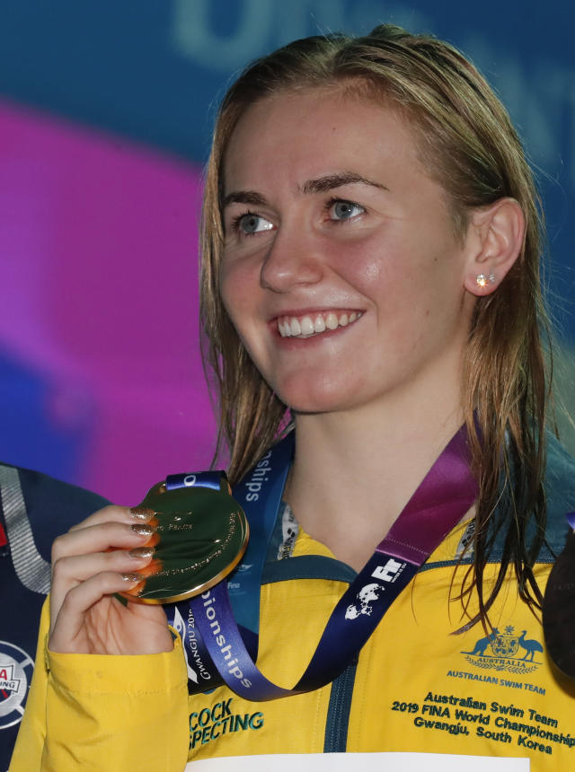 Gold medalist Australia's Ariane Titmus poses for a photo following the women's 400m freestyle final at the World Swimming Championships in Gwangju, South Korea, Sunday, July 21, 2019.(AP Photo/Lee Jin-man)