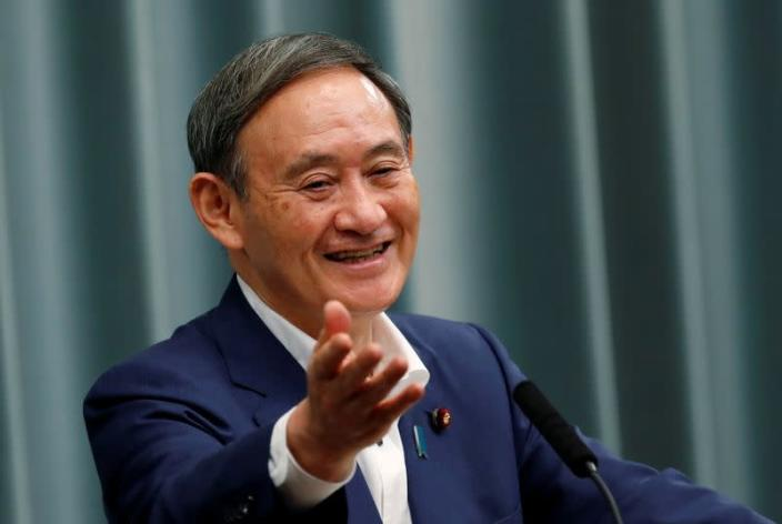 FILE PHOTO: Japan's Chief Cabinet Secretary Suga holds a regular news conference in Tokyo