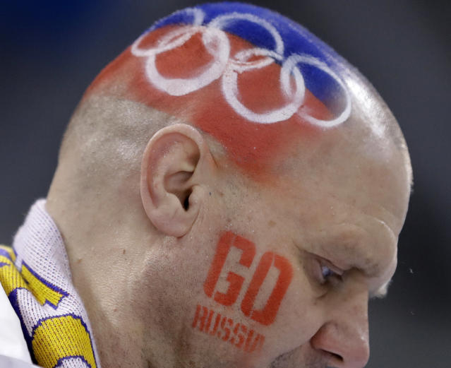A fan of Olympic Athletes from Russia gets ready before the semifinal round of the men's hockey game between the team from Russia and the Czech Republic at the 2018 Winter Olympics in Gangneung, South Korea, Friday, Feb. 23, 2018. (AP Photo/Matt Slocum)