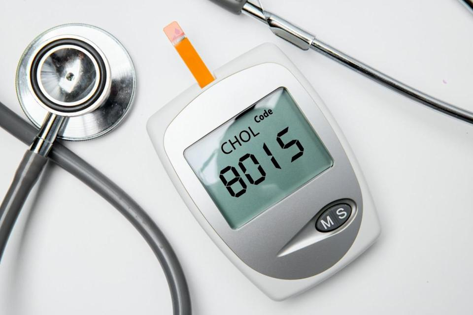 medical device for measuring cholesterol with stethoscope on the table.