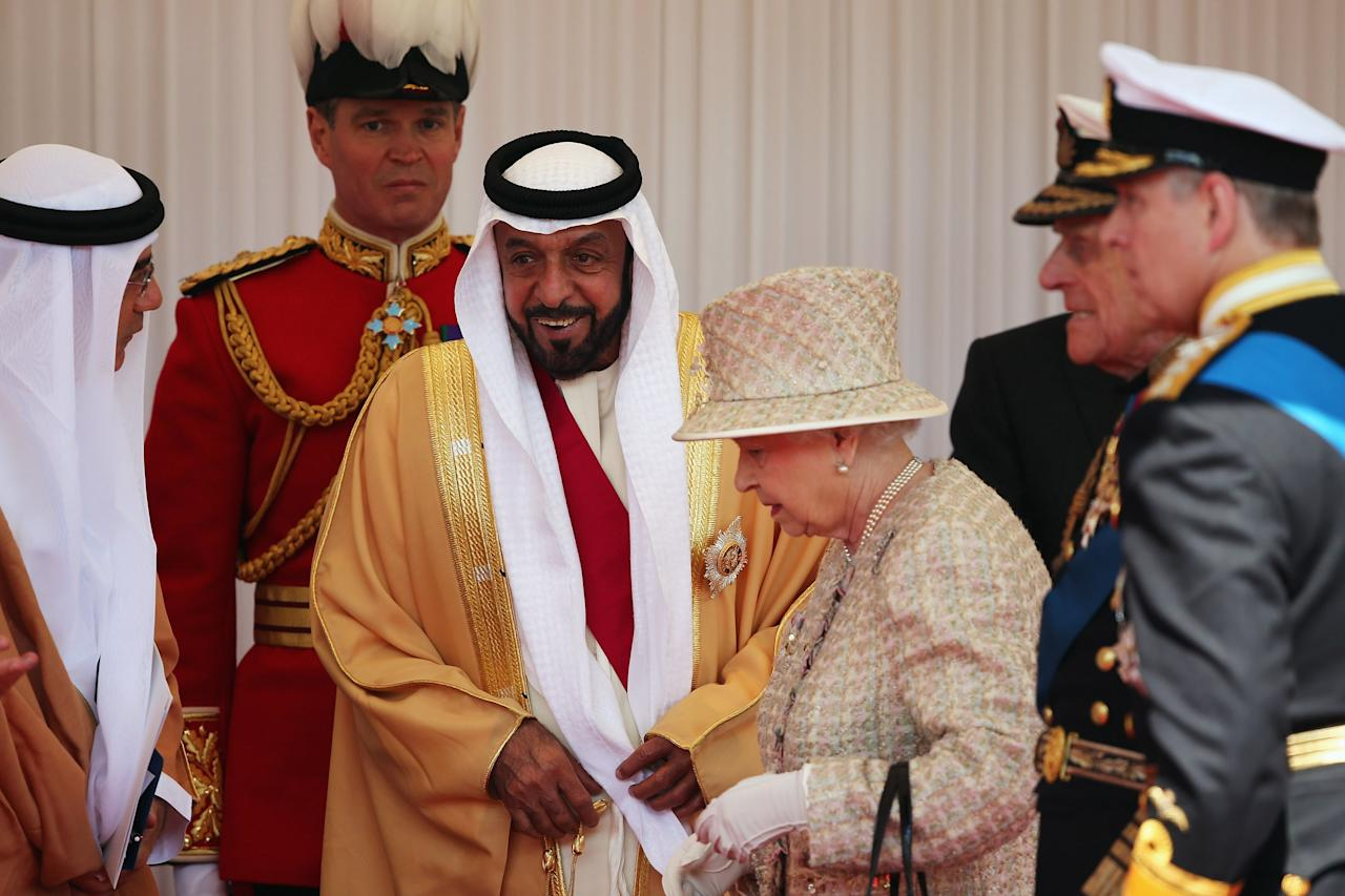 WINDSOR, ENGLAND - APRIL 30:  The President of the United Arab Emirates, His Highness Sheikh Khalifa bin Zayed Al Nahyan is greeted by Queen Elizabeth II and Prince Philip, the Duke of Edinburgh on the Royal Dais on April 30, 2013 in Windsor, England. President Sheikh Khalifa begins a State visit to the UK today, the first for a UEA President in 24 years. Sheikh Khalifa will meet the British Prime Minister David Cameron tomorrow at his Downing Street residence.  (Photo by Dan Kitwood/Getty Images)