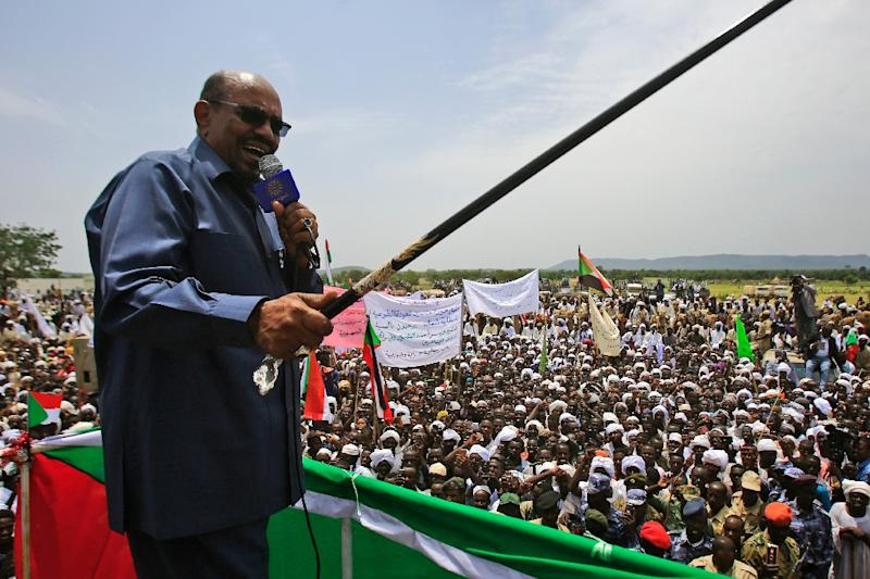 Sudanese President Omar al-Bashir, seen here during a visit to the village of Shattaya in South Darfur on September 22, remains under an ICC arrest warrant despite the end of the US trade embargo (AFP Photo/ASHRAF SHAZLY)
