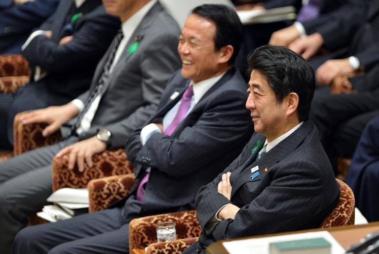 Japanese Prime Minister Shinzo Abe (R), accompanied by cabinet members, observes a Japanese Lower House session at the National Diet in Tokyo on April 16, 2013