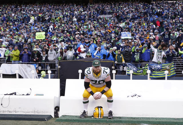 January 18, 2015; Seattle, WA, USA; Green Bay Packers guard T.J. Lang (70) reacts following the 28-22 loss against the Seattle Seahawks in the NFC Championship game at CenturyLink Field. (Joe Nicholson-USA TODAY Sports )