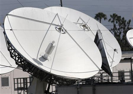 Large satellite dishes at the Los Angeles Broadcast Center of U.S. satellite TV operator DirecTV are seen in Los Angeles, California May 18, 2014. REUTERS/Jonathan Alcorn