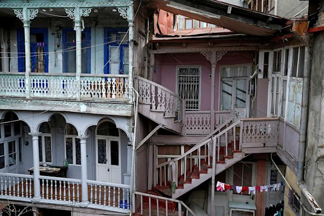 <p>Wooden stairs and balconies are seen in a courtyard in the old town, Tbilisi, Georgia, April 6, 2017. (Photo: David Mdzinarishvili/Reuters) </p>