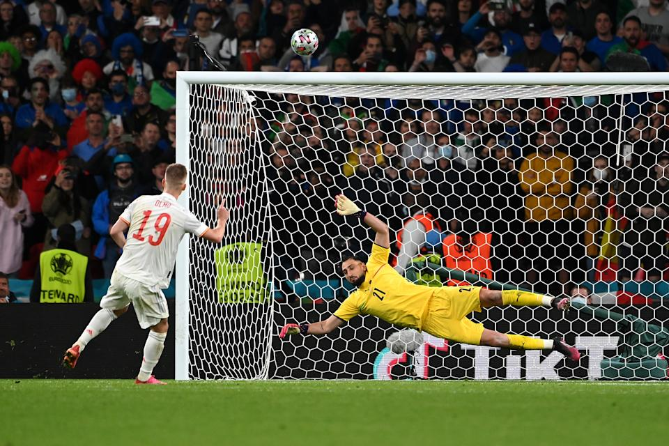 LONDON, ENGLAND - JULY 06: Dani Olmo of Spain misses their team's third penalty in the penalty shoot out during the UEFA Euro 2020 Championship Semi-final match between Italy and Spain at Wembley Stadium on July 06, 2021 in London, England. (Photo by Andy Rain - Pool/Getty Images)