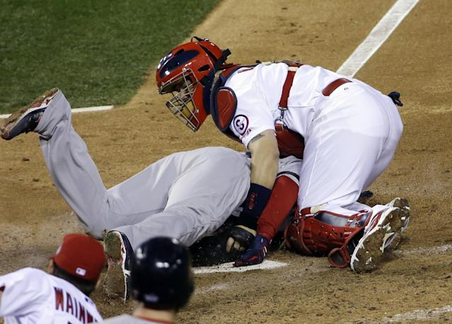 St. Louis Cardinals catcher Yadier Molina tags out Boston Red Sox's David Ross at home during the seventh inning of Game 5 of baseball's World Series Monday, Oct. 28, 2013, in St. Louis. (AP Photo/David J. Phillip)