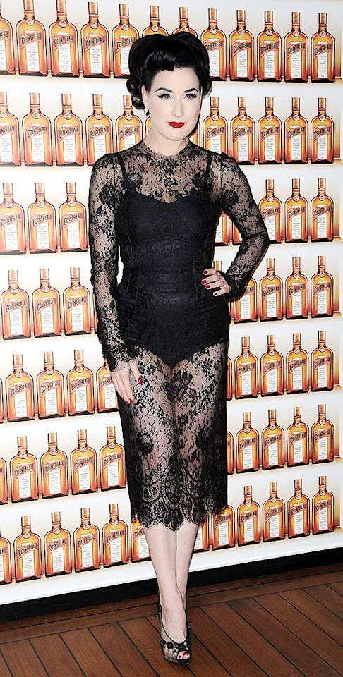 """Usually a trendsetter in her own right, burlesque star Dita Von Teese looked like a faded carbon copy of Gaga while at the Just Cavalli Cointreaupolitan cocktail party in Milan. Her lace ensemble also reminds us of Britney Spears' horrific Grammys getup. <a href=""""http://www.splashnewsonline.com"""" target=""""new"""">Splash News</a> - March 4, 2010"""