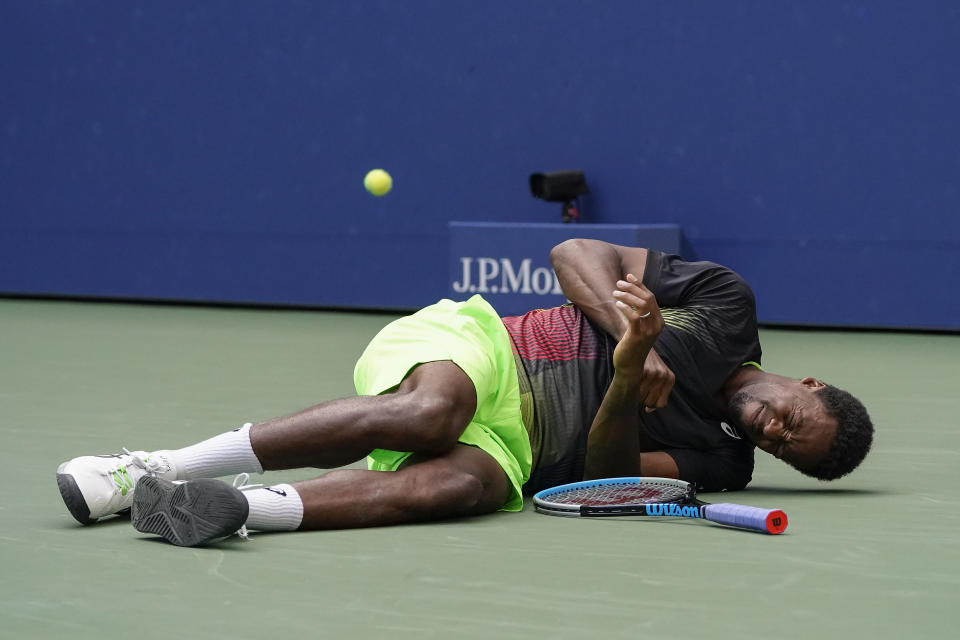 Gael Monfils, of France, reacts after falling to the court while chasing down a shot from Steve Johnson, of the United States, during the second round of the US Open tennis championships, Thursday, Sept. 2, 2021, in New York. (AP Photo/John Minchillo)
