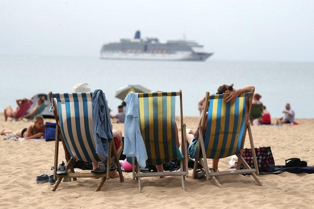 People enjoy the hot weather on Boscombe beach in Dorset, on August 8