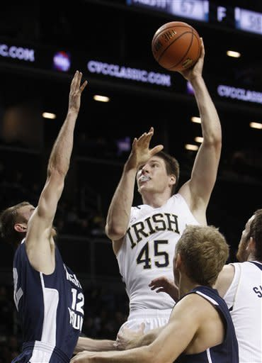 Notre Dame's Jack Cooley (45) shoots against Bringham Young's Josh Sharp (12) during the first half of their NCAA college basketball game in the consolation round of the Coaches vs. Cancer Classic at the Barclays Center, Saturday, Nov. 17, 2012, in New York. (AP Photo/Jason DeCrow)