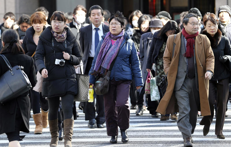 In this Jan. 17, 2014 photo, people walk through Ginza shipping district in Tokyo. Japan's consumer price index rose 0.4 percent in 2013, the first increase in five years, in further evidence the recovery in the world's third-largest economy is gaining momentum. (AP Photo/Koji Sasahara)