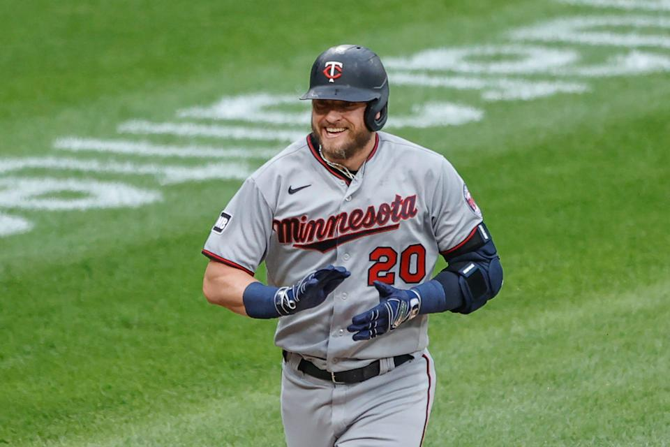Josh Donaldson smiles as he rounds the bases after hitting a two run home run against Lucas Giolito.
