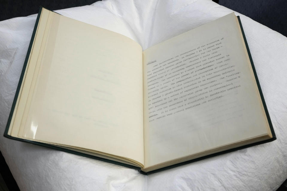 One of five copies of Professor Stephen Hawking's PhD thesis, Properties of Expanding Universes, which has been acquired by the Science Museum Group, in London, Wednesday, May 26, 2021. Science Museum Group and Cambridge University Library will announce that they have acquired the historic contents of Professor Stephen Hawking's office (going to SMG) and his archive (going to CUL). (AP Photo/Kirsty Wigglesworth)