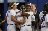 James Madison pitcher Odicci Alexander, center, facing camera, celebrates with teammates after the team's win over Oklahoma State in an NCAA Women's College World Series softball game, Friday, June 4, 2021, in Oklahoma City. (AP Photo/Sue Ogrocki)
