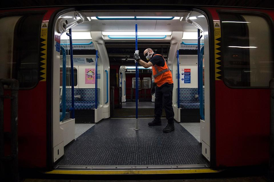 A staff member cleaning a Tube train (PA)