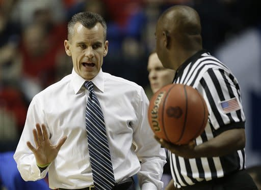 Florida head coach Billy Donovan speaks to an official during the first half of an NCAA college basketball game against LSU at the Southeastern Conference tournament, Friday, March 15, 2013, in Nashville, Tenn. (AP Photo/Dave Martin)