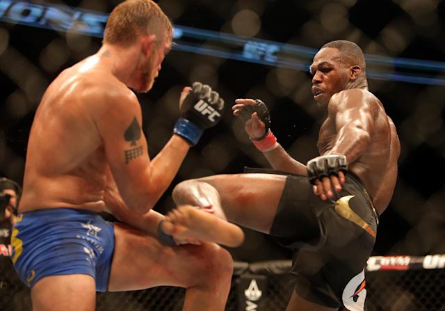 Jon Jones kicks Alexander Gustafsson (L) during their light heavyweight championship bout at UFC 165 at the Air Canada Centre. (Tom Szczerbowski-USA TODAY Sports)