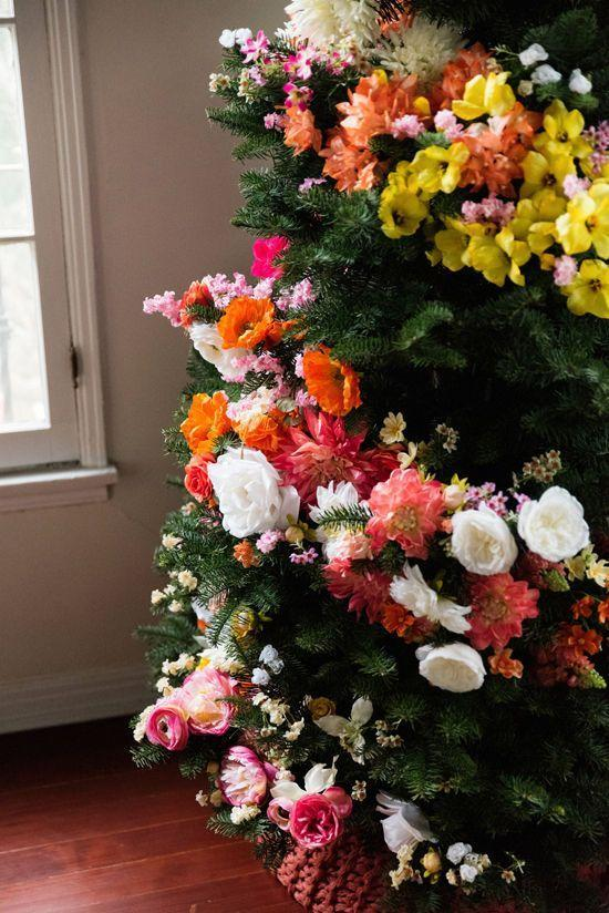 "<p>If you're skeptical about replacing your traditional lights and ornaments, try this gorg floral wrap on a smaller second tree. Just cut down silk flower stems and stick them in—the more the merrier.</p><p>Get the tutorial at <a href=""http://www.designlovefest.com/2015/12/diy-floral-tree/#comments"" rel=""nofollow noopener"" target=""_blank"" data-ylk=""slk:Design Love Fest"" class=""link rapid-noclick-resp"">Design Love Fest</a>.</p>"