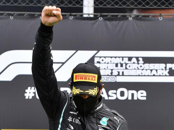 Lewis Hamilton gives the black power salute after winning the Styrian Grand Prix (AP)