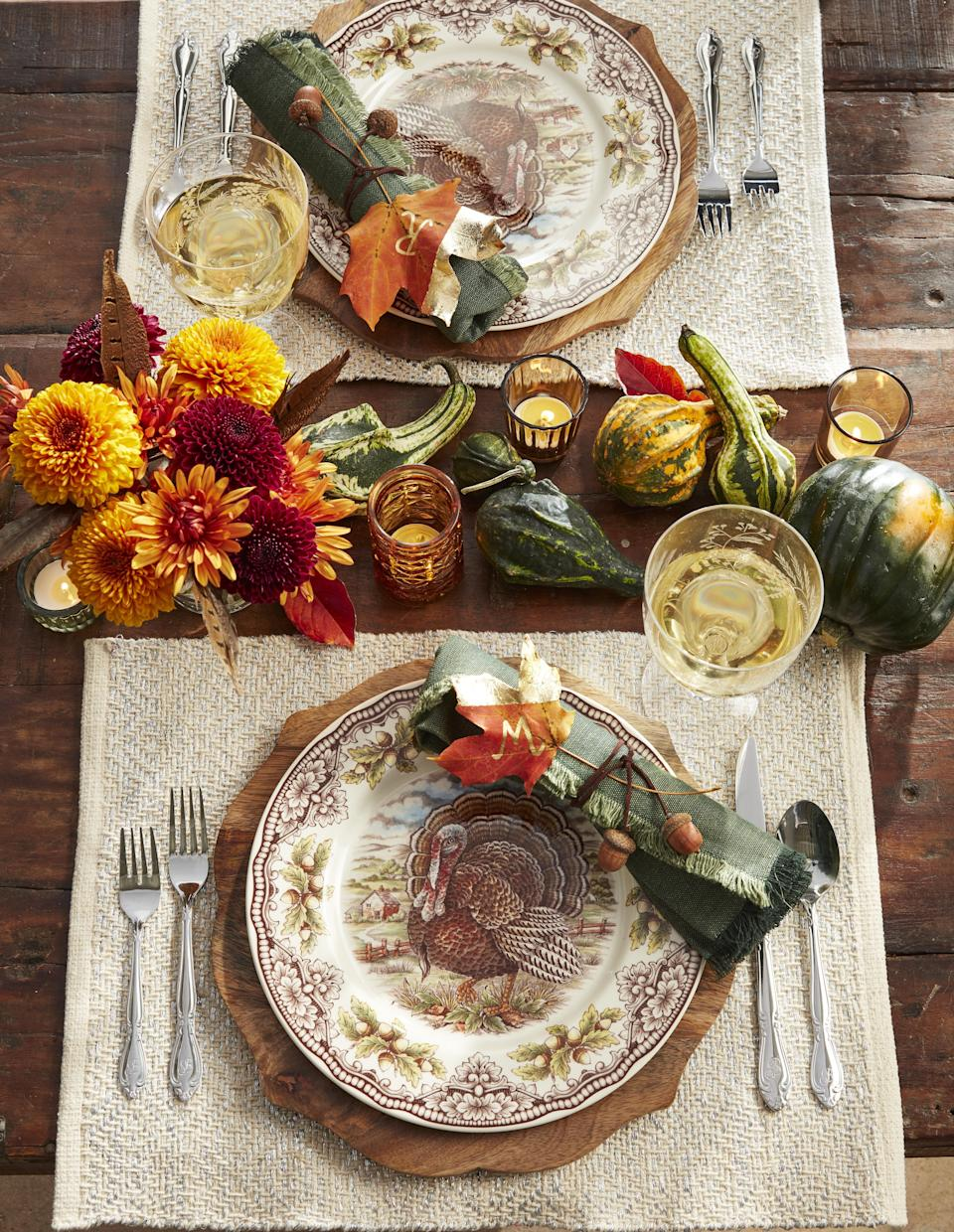 """<p>While you may love to experiment in the kitchen, when it comes to your <a href=""""https://www.countryliving.com/food-drinks/g637/thanksgiving-menus/"""" rel=""""nofollow noopener"""" target=""""_blank"""" data-ylk=""""slk:Thanksgiving menu"""" class=""""link rapid-noclick-resp"""">Thanksgiving menu</a> most families stick with tradition and prepare the same dishes year after year. Tradition has its place, but don't let your imagination be stifled. This year use that creativity and crafting know-how to make an inviting, unique fall scene with one of these easy DIY projects. From rustic <a href=""""https://www.countryliving.com/entertaining/g634/thanksgiving-table-settings-1108/"""" rel=""""nofollow noopener"""" target=""""_blank"""" data-ylk=""""slk:Thanksgiving table settings"""" class=""""link rapid-noclick-resp"""">Thanksgiving table settings</a> to easy Thanksgiving decorating ideas for your living and dining room, there's a new idea in here for just about every host—regardless of personal style or taste. Twirl up <a href=""""https://www.countryliving.com/entertaining/g2130/thanksgiving-centerpieces/"""" rel=""""nofollow noopener"""" target=""""_blank"""" data-ylk=""""slk:Thanksgiving centerpieces"""" class=""""link rapid-noclick-resp"""">Thanksgiving centerpieces</a> to delight all your dinner guests, make charming ice buckets out of fake, reusable pumpkins, or string together miniature wreaths with which to decorate your candles. When it comes to DIY decor, the possibilities are endless! </p><p>Looking for outdoor Thanksgiving decorations, too? We've got a ton of those: Our Thanksgiving <a href=""""https://www.countryliving.com/diy-crafts/g2610/fall-door-decorations/"""" rel=""""nofollow noopener"""" target=""""_blank"""" data-ylk=""""slk:door decorations"""" class=""""link rapid-noclick-resp"""">door decorations</a> and <a href=""""https://www.countryliving.com/diy-crafts/g1988/fall-craft-projects/"""" rel=""""nofollow noopener"""" target=""""_blank"""" data-ylk=""""slk:fall wreaths"""" class=""""link rapid-noclick-resp"""">fall wreaths</a> are an easy way to refresh your front porch and make a lasting """