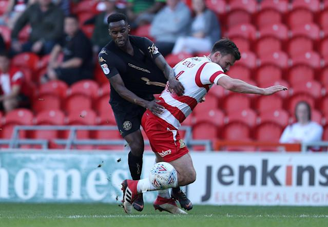 "Soccer Football - League One - Doncaster Rovers vs Wigan Athletic - Keepmoat Stadium, Doncaster, Britain - May 5, 2018 Wigan Athletic's Gavin Massey in action with Doncaster Rovers' Andrew Butler Action Images/John Clifton EDITORIAL USE ONLY. No use with unauthorized audio, video, data, fixture lists, club/league logos or ""live"" services. Online in-match use limited to 75 images, no video emulation. No use in betting, games or single club/league/player publications. Please contact your account representative for further details."