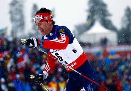FILE PHOTO: Russia's Maxim Vylegzhanin competes in the men's cross country 50 km mass start classic race during heavy snowfall at the Nordic World Ski Championships in Falun, Sweden March 1, 2015. REUTERS/Kai Pfaffenbach/File Photo