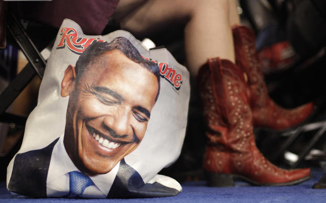<p>Colorado delegate Tracy Ducharme from Colorado Springs wears cowboy boots as she sit next to her bag showing President Barack Obama during the Democratic National Convention in Charlotte, N.C., on Sept. 4, 2012. (AP Photo/David Goldman) </p>