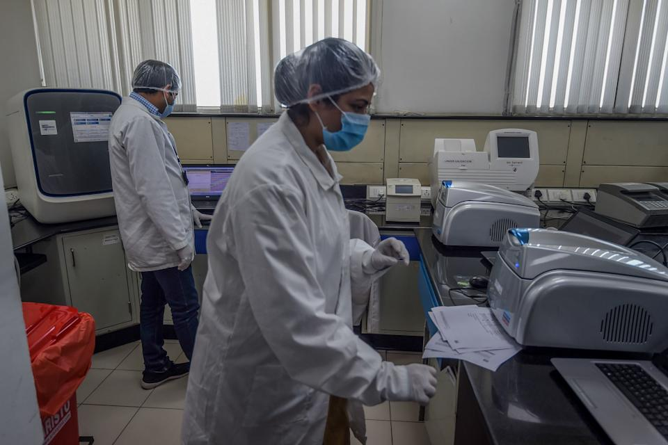 Employees of Dr Lal PathLabs check results of coronavirus tests (Photo by Money SHARMA / AFP) (Photo by MONEY SHARMA/AFP via Getty Images)