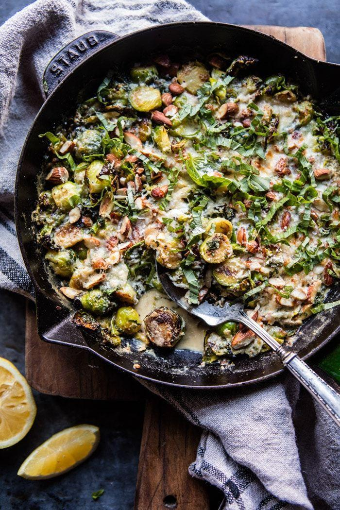 "<p>Goat cheese, Dijon mustard, and garlic makes these Brussels sprouts a crowd favorite.</p><p><strong>Get the recipe at <a href=""https://www.halfbakedharvest.com/lemony-fried-brussels-sprouts/"" rel=""nofollow noopener"" target=""_blank"" data-ylk=""slk:Half Baked Harvest"" class=""link rapid-noclick-resp"">Half Baked Harvest</a>.</strong></p>"